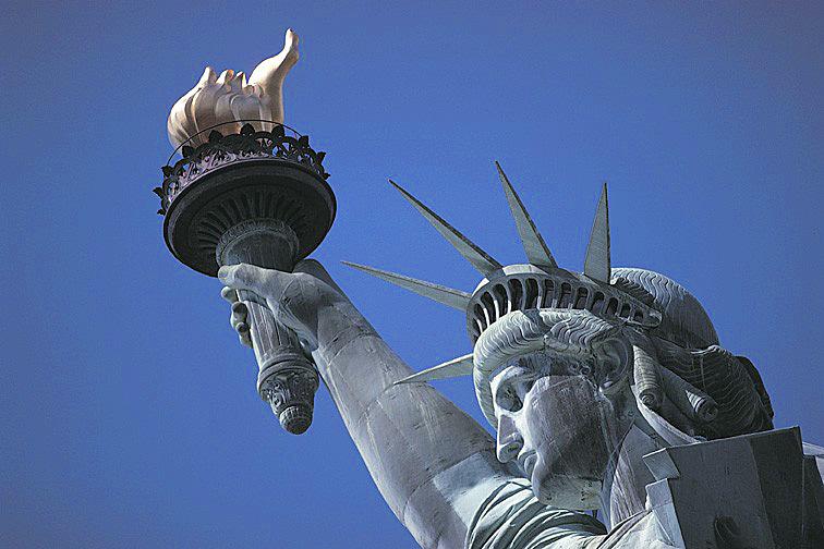 Statue de la Liberté, flamme et visage
